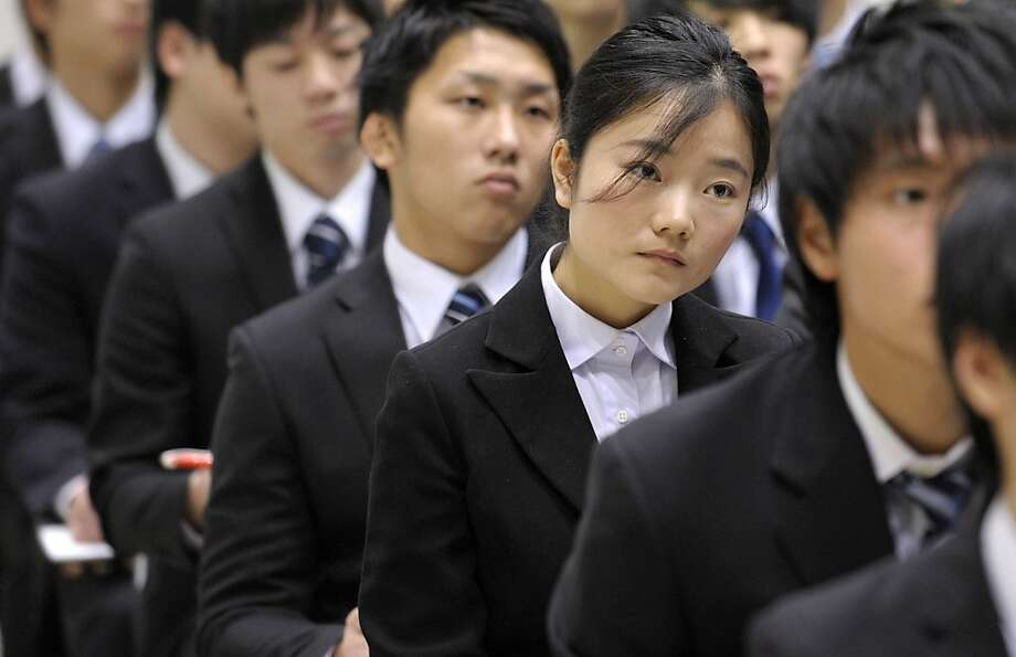 University students attend a presentation at a job fair hosted by Mynavi Corp. in Tokyo, Japan, on Saturday, Dec. 8, 2012. In Japan, many students accept job offers from large companies six months before graduating and may stay with the same employer until retirement, said Yoshihide Suzuki, an administrative director at the career center at Waseda University. Photographer: Akio Kon/Bloomberg Photo: Akio Kon, Bloomberg