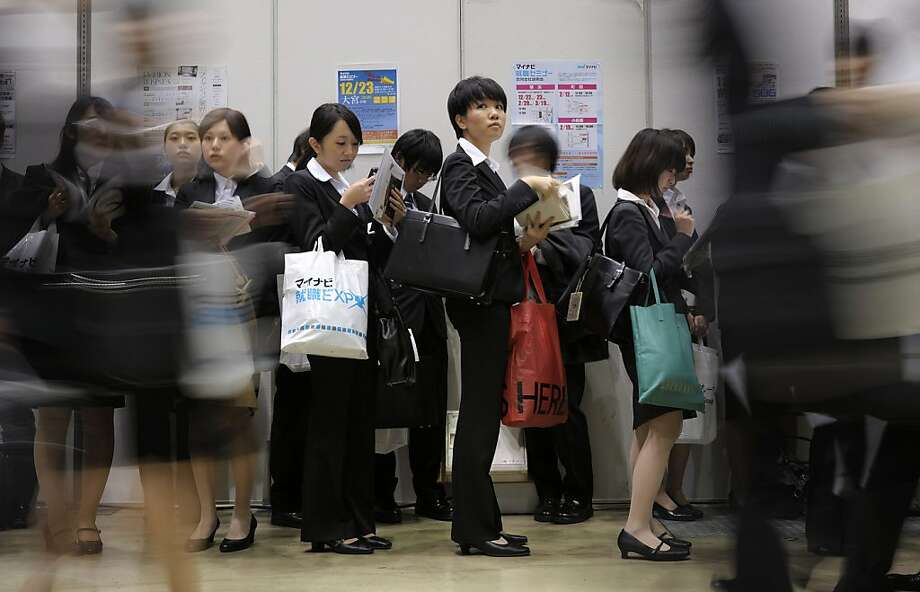 University students attend a job fair hosted by Mynavi Corp. in Tokyo, Japan, on Saturday, Dec. 8, 2012. In Japan, many students accept job offers from large companies six months before graduating and may stay with the same employer until retirement, said Yoshihide Suzuki, an administrative director at the career center at Waseda University. Photographer: Akio Kon/Bloomberg Photo: Akio Kon, Bloomberg