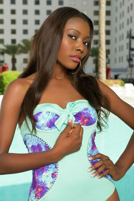 Miss Ghana 2012, Gifty Ofori, poses for photos in swimwear by Kooey Australia. Photo: Darren Decker, Miss Universe Organization / Miss Universe Organization