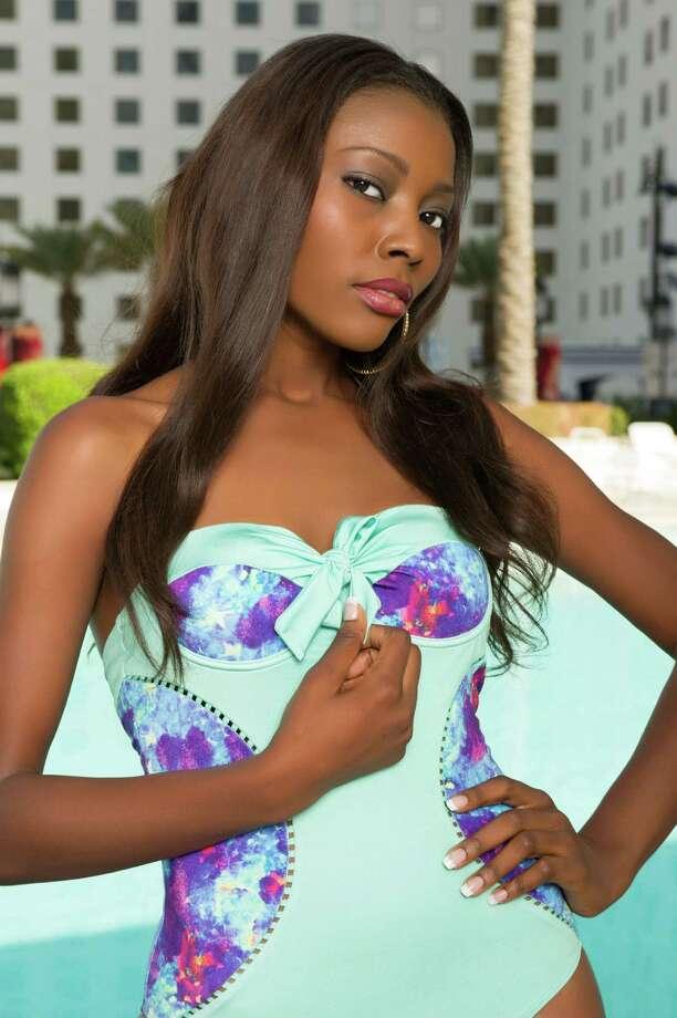 Miss Ghana 2012, Gifty Ofori, poses for photos in swimwear by Kooey Australia. Photo: Darren Decker, Miss Universe Organization / Miss Universe Organization