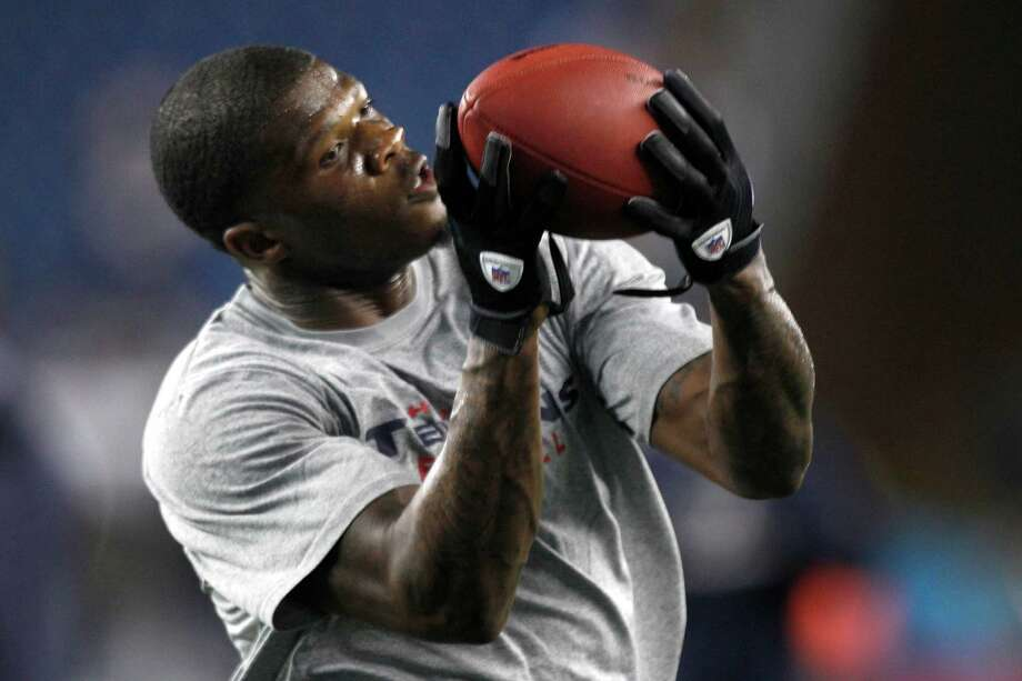Texans wide receiver Andre Johnson catches a football during warm-ups before a Monday Night Football game against the New England Patriots. Photo: Brett Coomer, Houston Chronicle / © 2012  Houston Chronicle