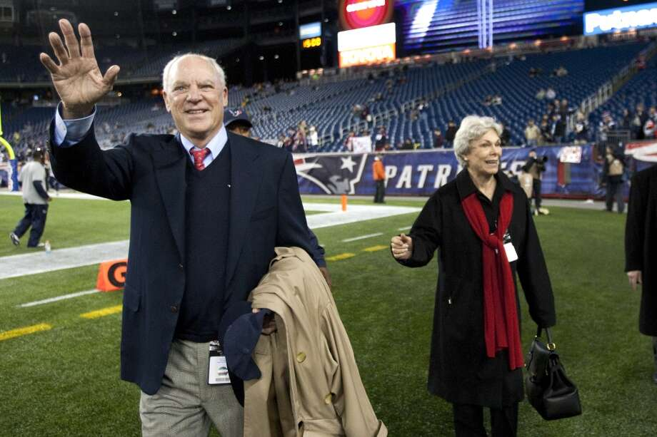 Texans owner Bob McNair, left, waves as he walks of the field with his wife, Janice. (Brett Coomer / Houston Chronicle)