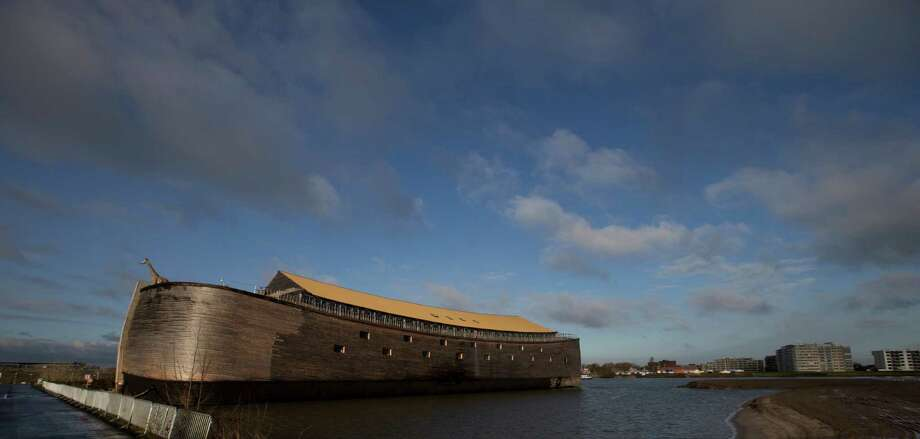 A full scale replica of Noah's Ark in seen in Dordrecht, Netherlands, Monday Dec. 10, 2012. The Ark opened its doors in the Netherlands after receiving permission to receive up to 3,000 visitors per day. For those who don't know or remember the Biblical story, God ordered Noah to build a boat massive enough to save animals and humanity while God destroyed the rest of the earth in an enormous flood. (AP Photo/Peter Dejong) Photo: Peter Dejong, Associated Press / AP