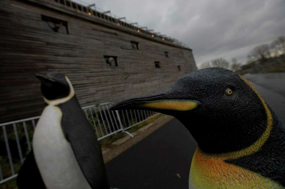Life-seize replica's of penguins are seen outside a full scale replica of Noah's Ark which has opened its doors in Doredrecth, Netherlands, Monday Dec. 10, 2012, after receiving permission to host up to 3,000 visitors per day. Stormy weather could do nothing to dampen the good mood of its creator, Dutchman Johan Huibers: in fact, the rain was appropriate. For those who don't know or remember the Biblical story, God ordered Noah to build a boat massive enough to save animals and humanity while God destroyed the rest of the earth in an enormous flood. (AP Photo/Peter Dejong) Photo: Peter Dejong, Associated Press / AP