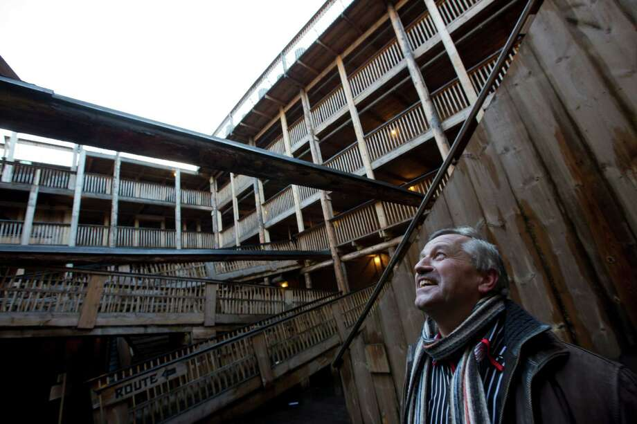 Johan Huibers looks up to the sky when showing journalists the inside of the full scale replica of Noah's Ark in Dordrecht, Netherlands, Monday Dec. 10, 2012. The Ark has opened its doors in the Netherlands after receiving permission to receive up to 3,000 visitors per day. For those who don't know or remember the Biblical story, God ordered Noah to build a boat massive enough to save animals and humanity while God destroyed the rest of the earth in an enormous flood. Johan's incredibly detailed interpretation measures in at a massive 130 meters (427 feet) long, 29 meters (95 feet) across and 23 meters (75 feet) high. (AP Photo/Peter Dejong) Photo: Peter Dejong, Associated Press / AP
