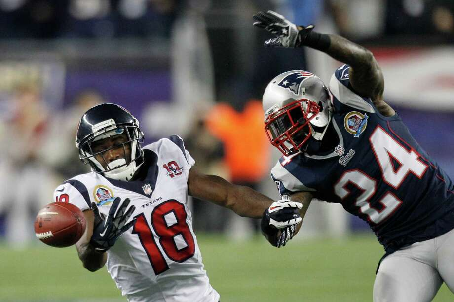 Texans wide receiver Lestar Jean (18) can't hold on to a pass as New England Patriots cornerback Kyle Arrington (24) defends during the first quarter. Photo: Brett Coomer, Houston Chronicle / © 2012  Houston Chronicle