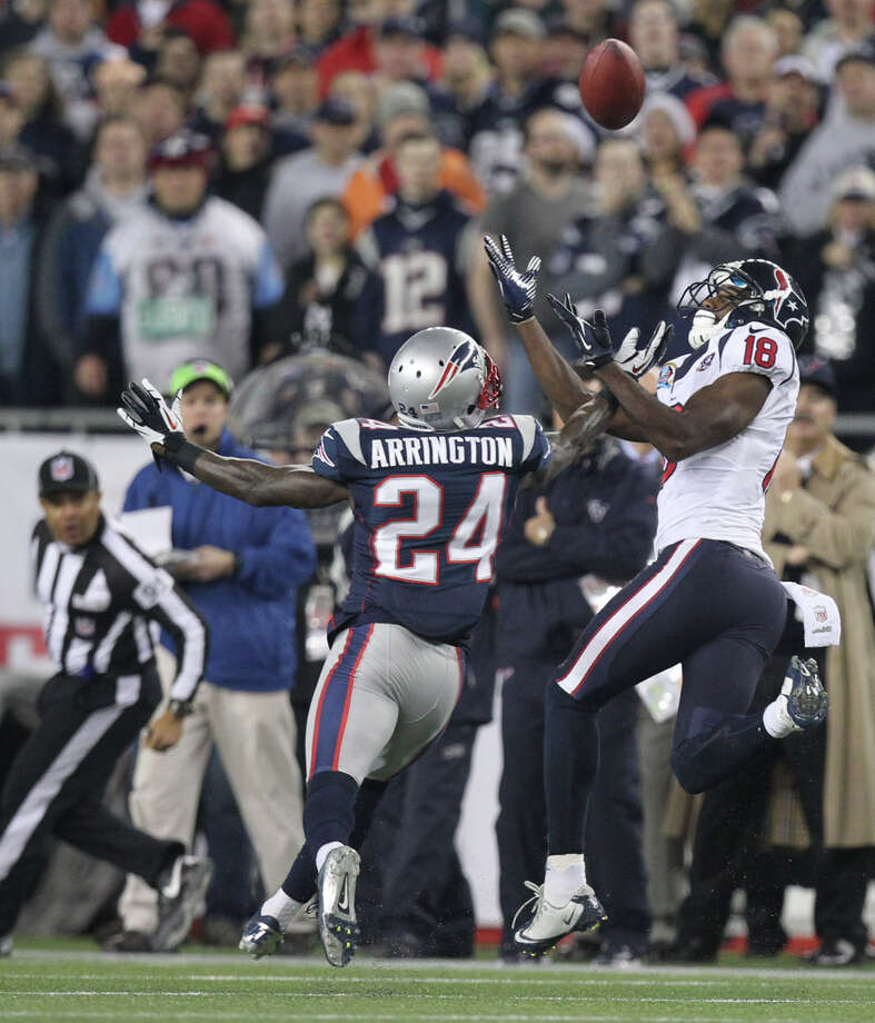 Texans wide receiver Lestar Jean (18) can't hold on to a pass as New England Patriots cornerback Kyle Arrington (24) defends. Photo: Nick De La Torre, Houston Chronicle / © 2012  Houston Chronicle