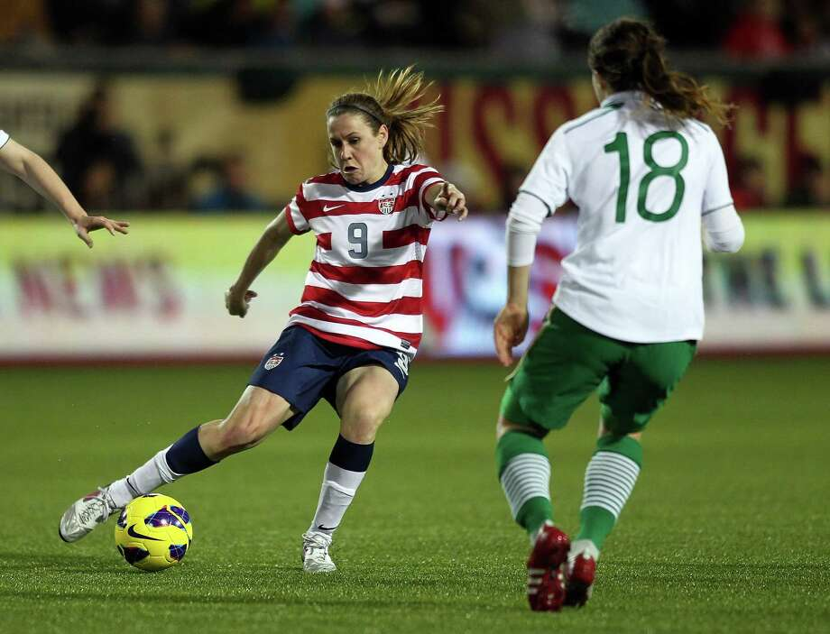 National team member Heather O'Reilly, left, praises U.S. Soccer for its involvement, financial and otherwise, in the new eight-team women's pro league. Photo: Jonathan Ferrey, Stringer / 2012 Getty Images