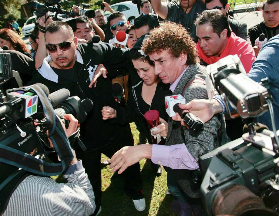 Jacqueline Rivera, center, daughter of singer Jenni Rivera, is swarmed by media as she arrives at her grandmother's home in Lakewood, Calif. Monday, Dec. 10, 2012. Jenni Rivera died Sunday in a plane crash in Mexico. (AP Photo/Jason Redmond) Photo: Jason Redmond, Associated Press / FR74394 AP