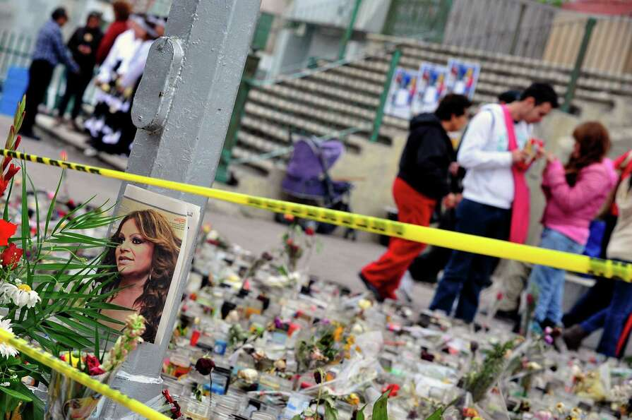 A portrait of Mexican-US singer Jenni Rivera remains outside the Arena Monterrey, where she performe