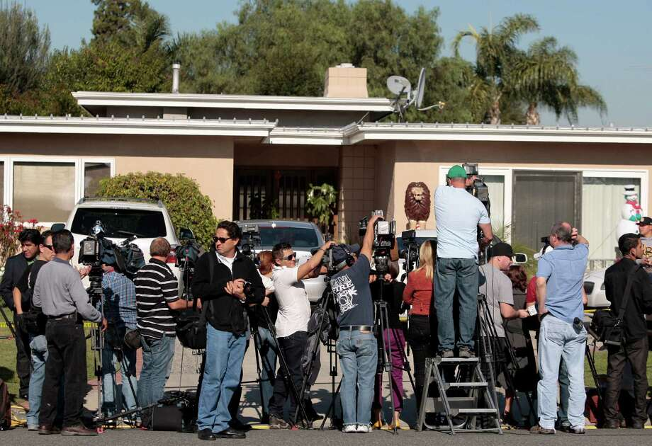 Media gather outside the home of singer Jenni Rivera's mother in Lakewood, Calif. Monday, Dec. 10, 2012. Rivera died Sunday in a plane crash in Mexico. U.S. authorities confirmed Monday that Jenni Rivera, a U.S.-born singer whose soulful voice and openness about her personal troubles made her a Mexican-American superstar, was killed Sunday in a plane crash in northern Mexico. (AP Photo/Jason Redmond) Photo: Jason Redmond, Associated Press / FR74394 AP