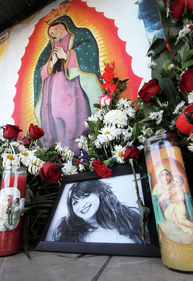 Photos and flowers honoring late singer Jenni Rivera, placed by fans next to religious images, are seen at the cemetery where her mother is buried in Hermosillo, northern Mexico, Monday, Dec. 10, 2012. U.S. authorities confirmed Monday that Rivera, a U.S.-born singer whose soulful voice and openness about her personal troubles made her a Mexican-American superstar, was killed in a plane crash early Sunday in northern Mexico. (AP Photo/Baldemar De Los Llanos) Photo: Baldemar De Los Llanos, Associated Press / AP