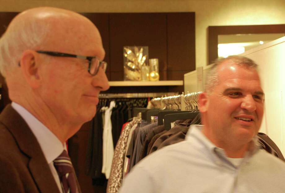 Bill Mitchell, left, co-owner of Mitchells of Westport store, chats with Deputy Police Chief Foti Koskinas at an event Monday evening to celebrate and acknowledge the town's first responders during Hurricane Sandy. Westport CT 12/10/12 Photo: Jarret Liotta / Westport News contributed