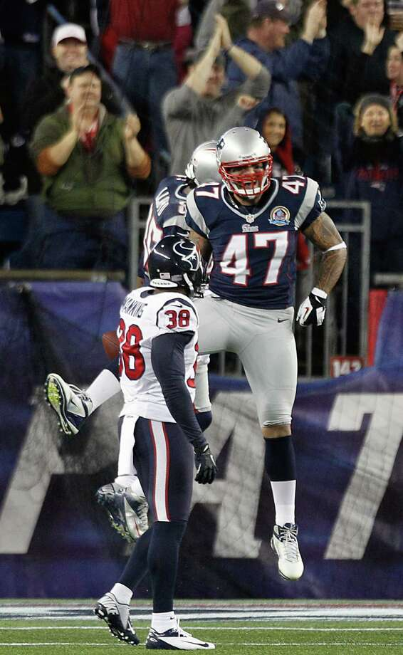 New England Patriots tight end Michael Hoomanawanui (47) celebrates with Brandon Lloyd as Houston Texans free safety Danieal Manning (38) looks on after Lloyd scored on a touchdown pass during the first quarter. Photo: Brett Coomer, Houston Chronicle / © 2012  Houston Chronicle