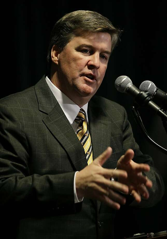 Mike MacIntyre is introduced as Colorado's head coach. Photo: Brennan Linsley, Associated Press