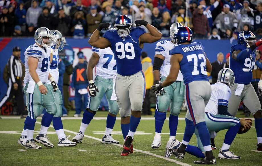 New York Giants defensive tackle Chris Canty (99) celebrates after he sacks Dallas Cowboys quarterback Tony Romo (9) in the 2nd half of the Giants 31-14 win. New York Giants against the Dallas Cowboys at MetLife Stadium.  1/1/2012 Photo: Ron Antonelli / New York Daily News