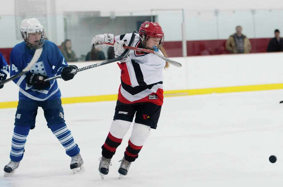 Greenwich high school's Maddy Graves goes after the puck in front of the Portledge school's goal in a girls ice hockey game played at Dorothy Hamill ice rink, Greenwich CT Monday December 10th 2012. Photo: Mark Conrad / Stamford Advocate Freelance