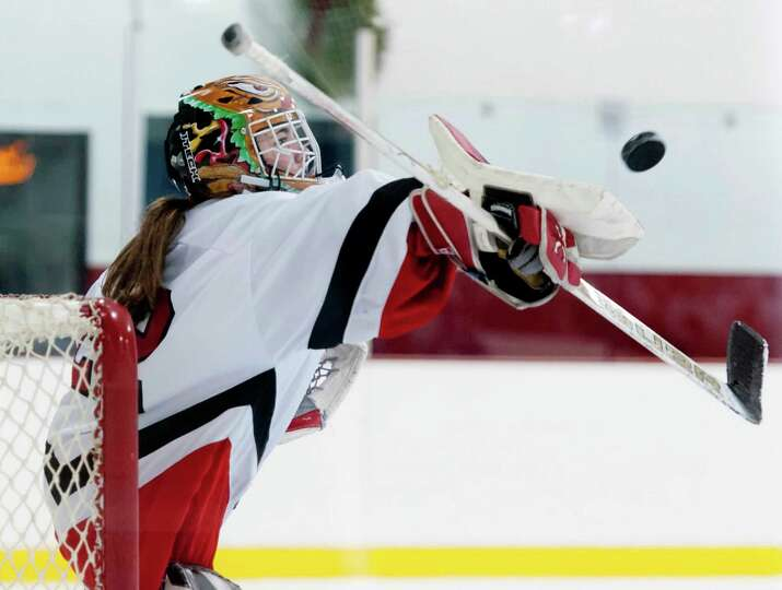 Greenwich high school goalie Lisa Lewis makes a save during a girls ice hockey game against Portledg