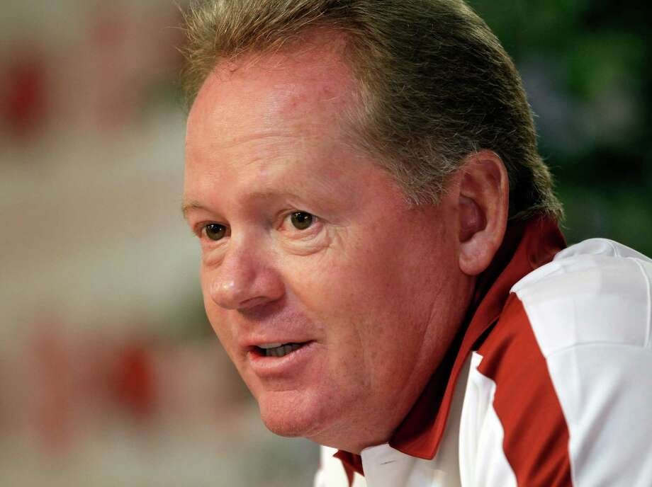 FILE - In this file photo taken Aug. 6, 2011, then Arkansas NCAA college football coach Bobby Petrino discusses the Razorbacks prospects during a news conference in Fayetteville, Ark. Western Kentucky has hired Petrino as its new football coach, said a person familiar with the decision. The person said the former Arkansas coach is expected to be introduced at a Monday, Dec. 10, 2012, news conference. The person spoke to The Associated Press on condition of anonymity because the school has not officially announced Petrino's hiring. (AP Photo/Danny Johnston, file) Photo: Danny Johnston