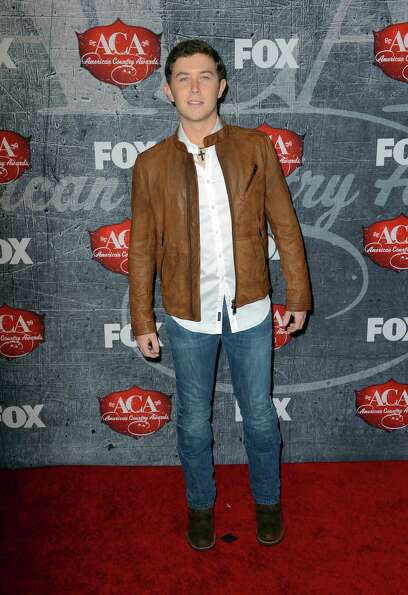 Singer Scotty McCreery arrives.