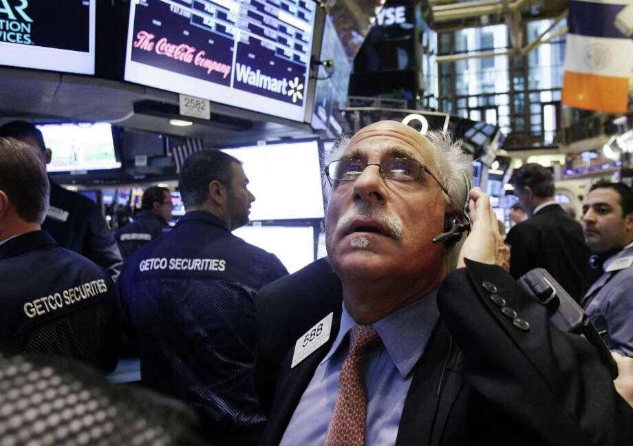 FILE - In this Thursday, Dec. 6, 2012 file photo, trader Peter Tuchman works on the floor of the New York Stock Exchange, in New York. Stocks are opening mixed on Wall Street, Monday, Dec. 10, 2012, after the surprise resignation of Italy's prime minister sent a jolt through European markets. (AP Photo/Richard Drew, File) Photo: Richard Drew