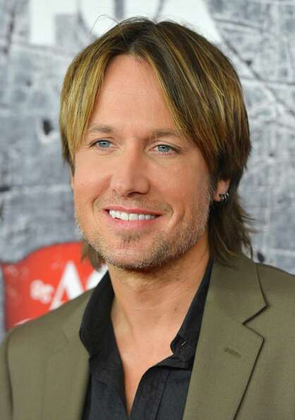 Singer Keith Urban arrives.
