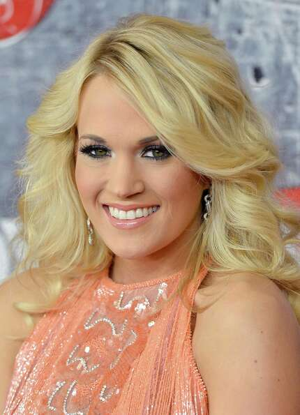 Singer Carrie Underwood arrives.