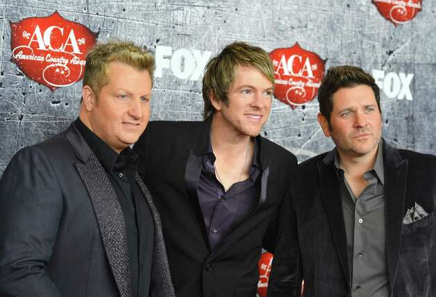 (L-R) Musicians Gary LeVox, Joe Don Rooney and Jay DeMarcus of Rascal Flatts arrive. Photo: Frazer Harrison, Getty Images / 2012 Getty Images