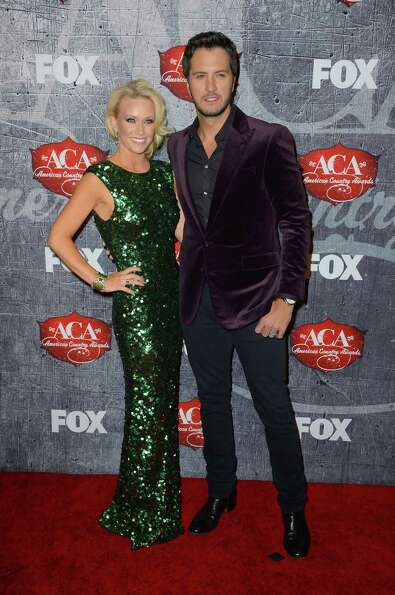 Singer Luke Bryan (R) and Caroline Boyer arrive.