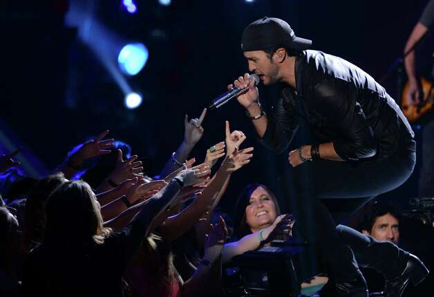 Singer Luke Bryan performs onstage. Photo: Mark Davis, Getty Images / 2012 Getty Images