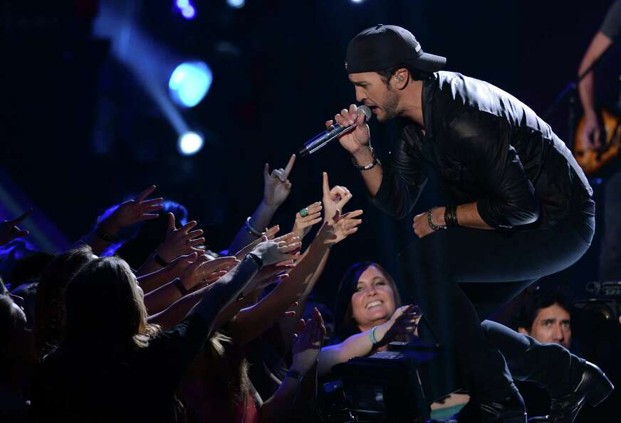 Singer Luke Bryan performs onstage.