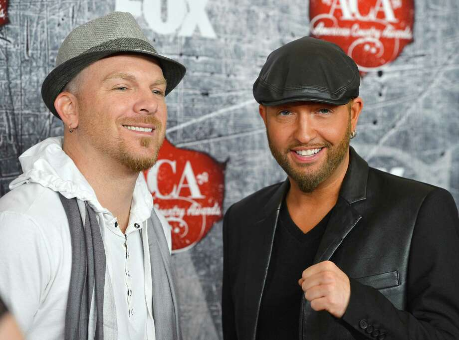 Recording artists Chris Lucas (L) and Preston Brust of the LoCash Cowboys arrive. Photo: Frazer Harrison, Getty Images / 2012 Getty Images