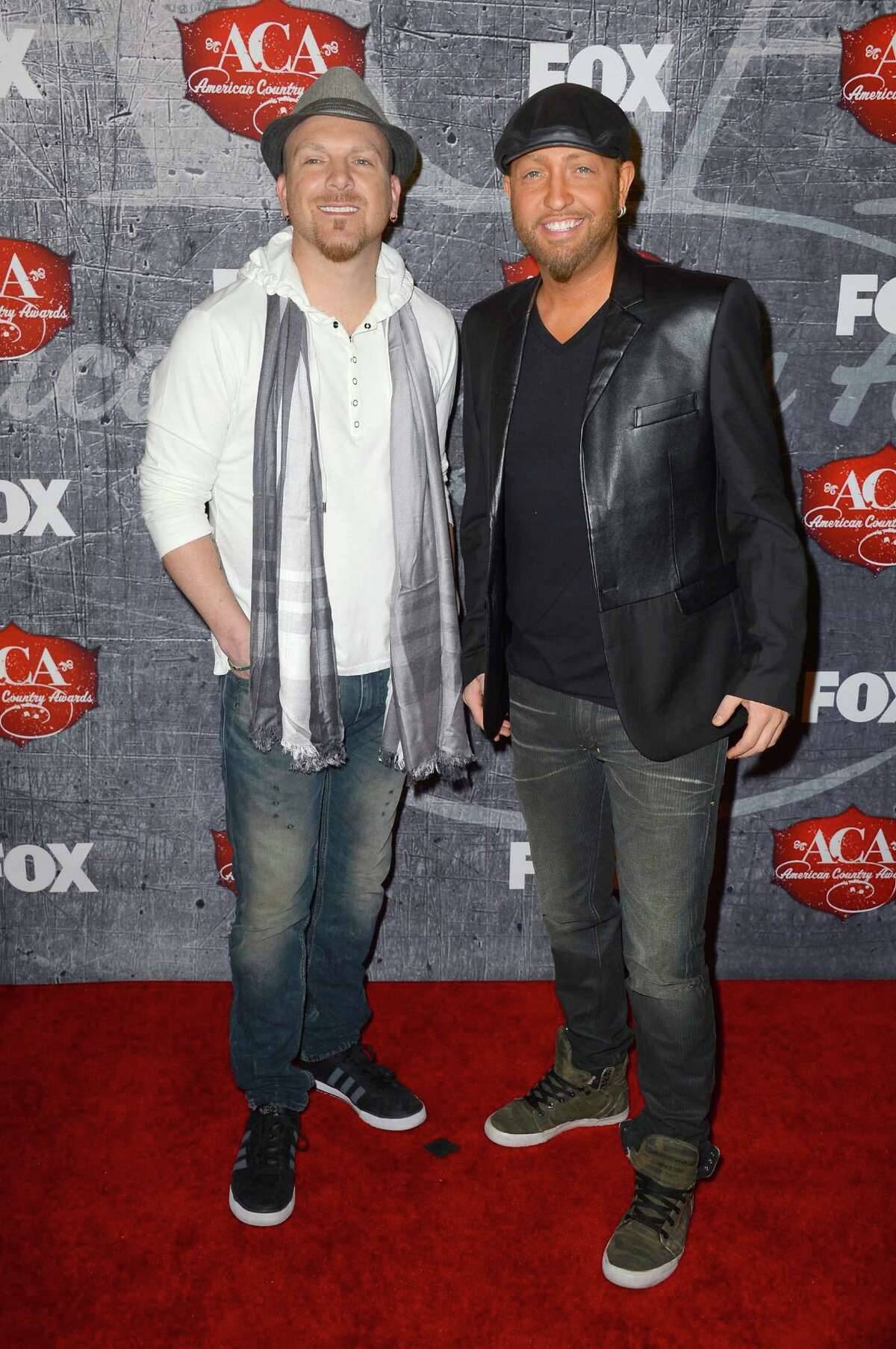 Recording artists Chris Lucas (L) and Preston Brust of the LoCash Cowboys arrive.