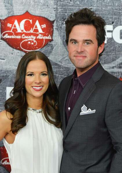 Recording artist David Nail (R) and his wife Catherine Nail arrive.