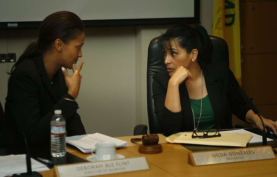 Deborah Ale Flint (left), acting executive director of the Oakland Port, confers with Port Commissioner Gilda Gonzales. Photo: Liz Hafalia, The Chronicle