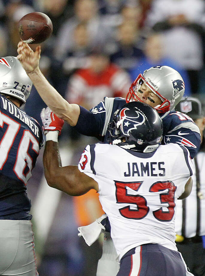 New England Patriots quarterback Tom Brady (12) gets off a pass as he is hit by Houston Texans inside linebacker Bradie James (53) during the second quarter. Photo: Brett Coomer, Houston Chronicle / © 2012  Houston Chronicle