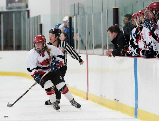 Greenwich high school's Emily Bacon moves the puck up ice in a girls ice hockey game against Portledge school played at Dorothy Hamill ice rink, Greenwich CT Monday December 10th 2012. Photo: Mark Conrad / Stamford Advocate Freelance