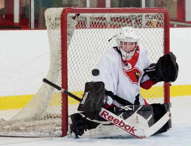 Greenwich high school goalie Dart Freccia makes a save in a girls ice hockey game against Portledge school played at Dorothy Hamill ice rink, Greenwich CT Monday December 10th 2012. Photo: Mark Conrad / Stamford Advocate Freelance