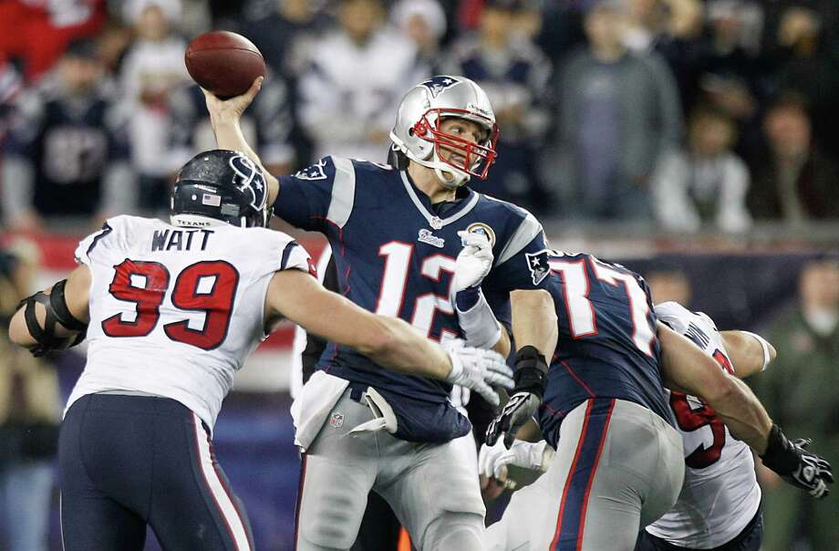 Patriots quarterback Tom Brady (12) gets off a pass as Texans defensive end J.J. Watt (99) applies pressure during the second quarter. Photo: Brett Coomer, Houston Chronicle / © 2012  Houston Chronicle