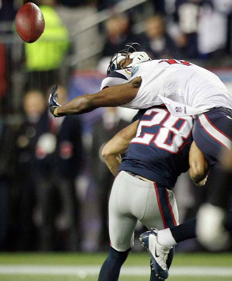 Patriots strong safety Steve Gregory (28) breaks up a pass intended for Texans wide receiver Lestar Jean (18) during the second quarter. Photo: Brett Coomer, Houston Chronicle / © 2012  Houston Chronicle