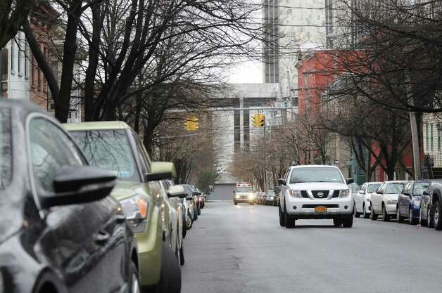 Vehicles parked on Hudson Avenue near the Empire State Plaza, Monday Dec. 10, 2012, in Albany, N.Y. The new tentative date for the start of Albany?s downtown parking permit system is Jan. 15. (Will Waldron / Times Union) Photo: Will Waldron