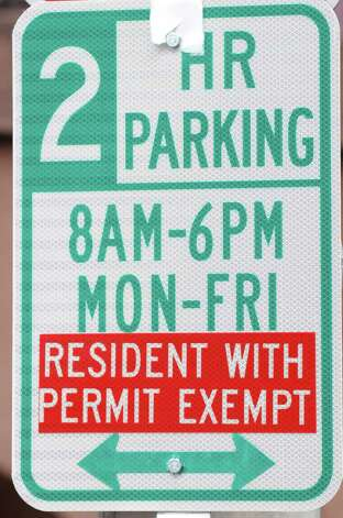 An uncovered permit parking sign is seen on Dove Street, Monday Dec. 10, 2012, in Albany, N.Y. The new tentative date for the start of Albany?s downtown parking permit system is Jan. 15. (Will Waldron / Times Union) Photo: Will Waldron