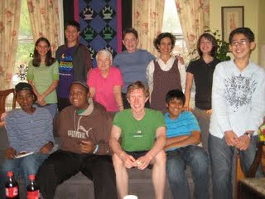 Members and mentors of Children at the Well, back row left to right: Emily Hebert, Ben Russell, Marni Gillard, Mary Murphy, Paula Weiss and Ilyssa Simsek. Front row, left to right: Khalafalla Osman, Alaudeen Umar, John Lyden, Ritam Mehta and Toma Tadros. (Leo Wong)