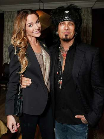 IMAGE DISTRIBUTED FOR HOUSE OF ROCK - Courtney Bingham and Nikki Sixx attend the 98.7 Saves Christmas Party at The House of Rock on Wednesday, Dec. 5, 2012, in Los Angeles, Calif. (Photo by Todd Williamson/Invision for House of Rock/AP) Photo: Todd Williamson / Invision