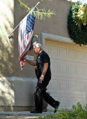 Jerry Meltzer, a neighbor of Matthew Good, walks back into his home after speaking about his now famous neighbor Matthew Good, Monday  Dec. 10, 2012, in Fountain Hills, Ariz.  The second winner of the $587.5 million Powerball jackpot is the 37-year-old Good, who chose to remain anonymous, took the one-time payout of $192 million from the Nov. 28 drawing.(AP Photo/Ross D. Franklin) Photo: Ross D. Franklin
