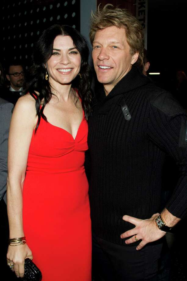 "Julianna Margulies and Jon Bon Jovi attend the premiere of ""Stand Up Guys"" hosted by The Cinema Society and Chrysler on Sunday, Dec. 9, 2012 in New York. (Photo by Charles Sykes/Invision/AP) Photo: Charles Sykes"