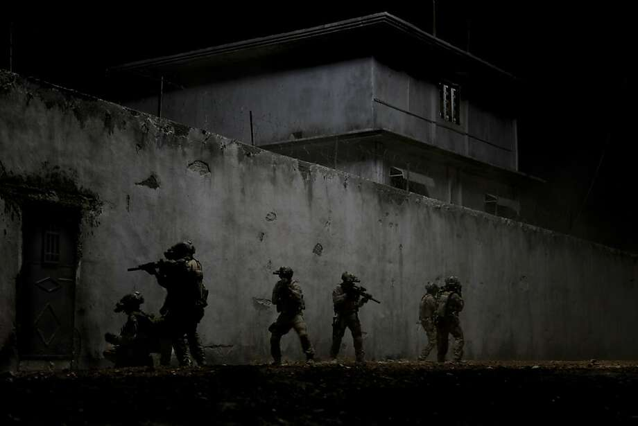 """FILE - This undated publicity film image provided by Columbia Pictures Industries, Inc. shows elite Navy SEALs raiding Osama Bin Laden's compound in the dark night in Columbia Pictures' gripping new thriller directed by Kathryn Bigelow, """"Zero Dark Thirty."""" Bigelow's Osama bin Laden thriller """"Zero Dark Thirty,"""" Steven Spielberg's Civil War epic """"Lincoln"""" and Christopher Nolan's superhero tale """"The Dark Knight Rises"""" are among the American Film Institute's top-10 movies of the year., announced on Monday, Dec. 10, 2012. (AP Photo/Columbia Pictures Industries, Inc., Jonathan Olley, File) Photo: Jonathan Olley, Associated Press"""