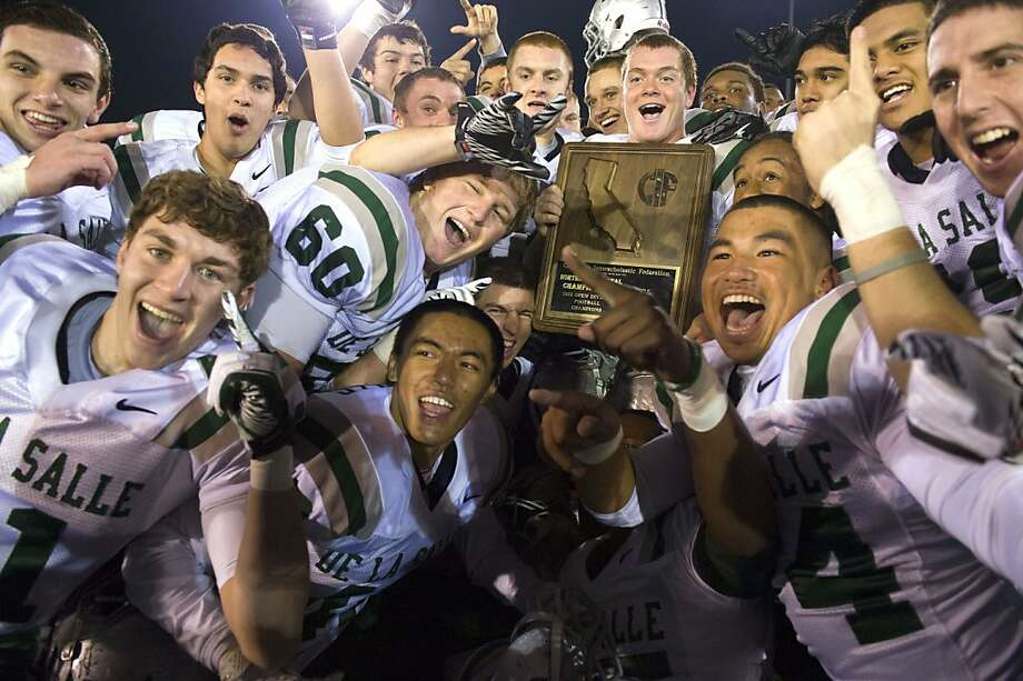 De La Salle, celebrating its 49-15 win over Folsom in the North Region final, meets Centennial, the highest-scoring team in California, in Saturday's Open Division state championship. Photo: Brian Baer, Special To The Chronicle