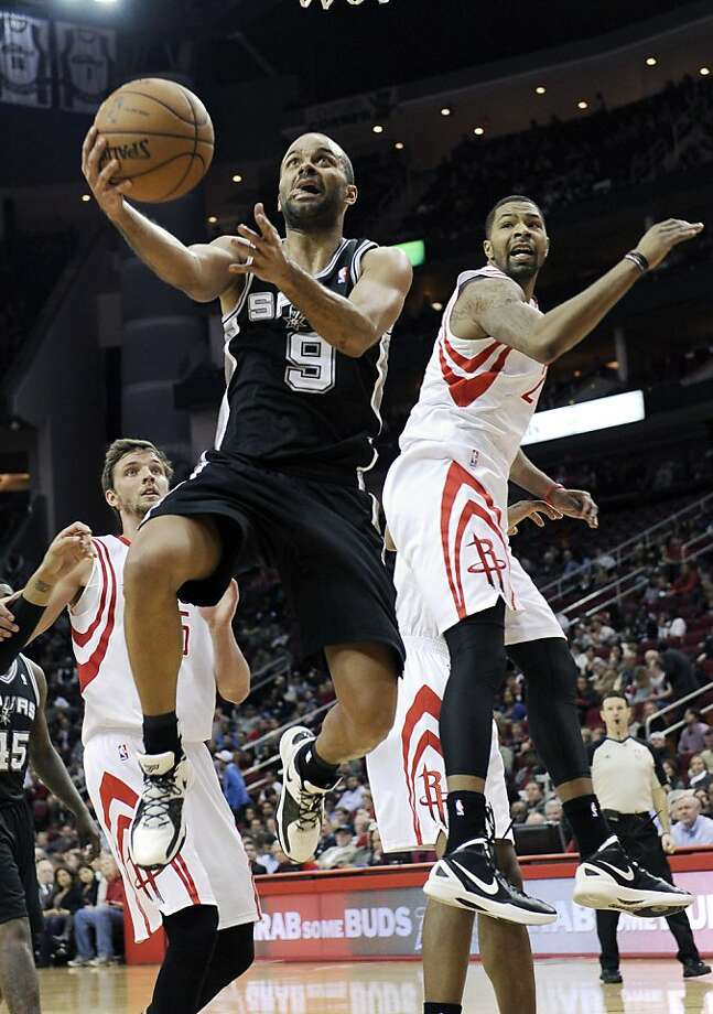 Tony Parker had 27 points, 12 rebounds and 12 assists as the Spurs beat the Rockets in overtime. Photo: Pat Sullivan, Associated Press