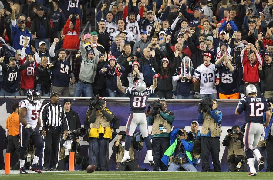 New England Patriots tight end Aaron Hernandez (81) celebrates after scoring on a touchdown pass fro